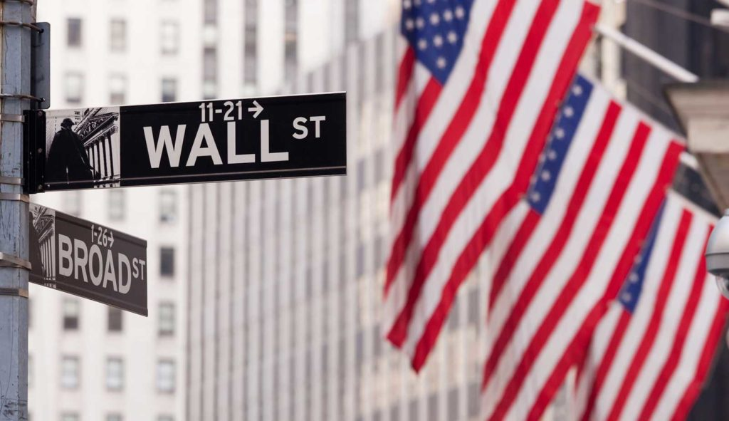Wall St sign and american flags